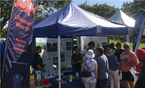 People at a Maritime Safety Queensland event promoting lifejacket use and safety