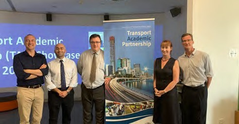 Departmental staff and university professors at a Transport Academic Partnership event