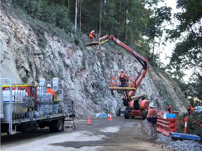 Crews performing landslip reconstruction with machinery