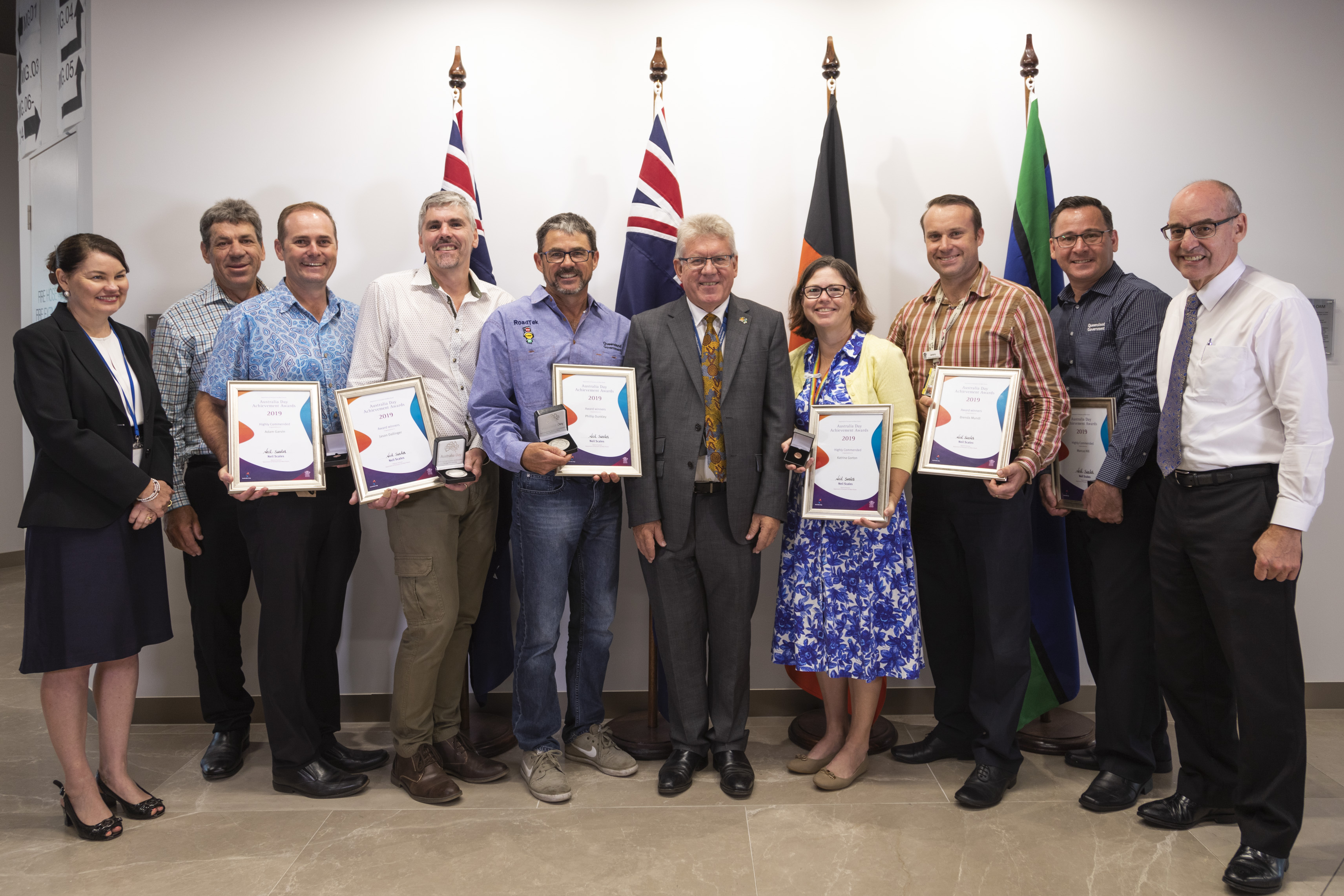 Director-General Neil Scales, Deputy Director-General (CSSR) Mike Stapleton and Deputy Director-General (Corporate) Tracy O'Bryan with the award recipients at the Australia Day Awards.